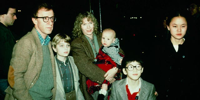 Woody Allen with Mia Farrow and children, including Soon-Yi Previn.