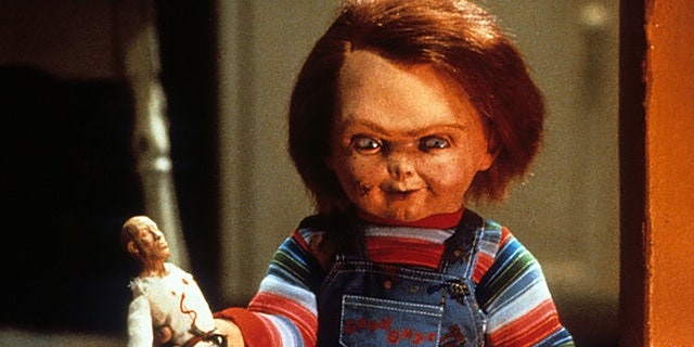 Chucky with doll in a scene from the film 'Child's Play', 1988. (Photo by United Artists/Getty Images)
