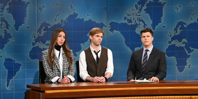 "Pictured here is Heidi Gardner as Janet Noonan and Mikey Day as Lowell Fitzroy with anchor Colin Jost during ""Saturday Night Live's"" Weekend Update on Feb. 6. (Will Heath/NBC/NBCU Photo Bank via Getty Images/)"