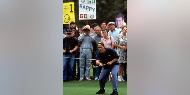 Adam Sandler plays golf in a scene from the film 'Happy Gilmore.' (Photo by Universal/Getty Images)