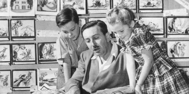 American film director, animator, and businessman Walt Disney with Bobby Driscoll and Luana Patten in 1946.