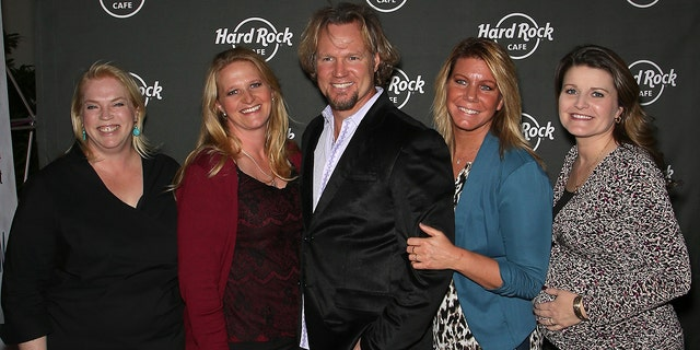 Television personalities Kody Brown (C) and his wives, (L-R) Janelle Brown, Christine Brown, Meri Brown and Robyn Brown attend Hard Rock Cafe Las Vegas at Hard Rock Hotel's 25th-anniversary celebration on October 10, 2015, in Las Vegas, Nevada.
