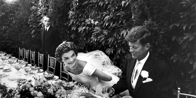 Sen. John Kennedy and Jacqueline Lee Bouvier (wearing Ann Lowe) enjoy their wedding reception, 1953.