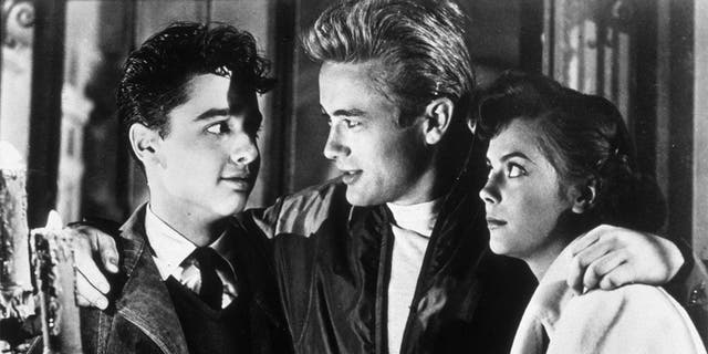 American actors Sal Mineo (1939 - 1976), James Dean (1931 - 1955) and Natalie Wood (1938 - 1981) in a still from director Nicholas Ray's film 'Rebel Without a Cause'.
