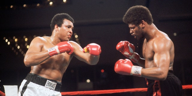2/14/1978-Las Vegas, NV: Muhammad Ali (left) and Leon Spinks during ring action at the Las Vegas Hilton Pavilion. Spinks scored one of boxing's greatest upsets when he captured the world heavyweight championship with a 15-round split decision over Ali. Profile shot of the two boxers facing off.