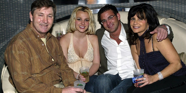 Lynne Spears (right) claimed in a new court document that a fees request submitted by her father Jamie Spears (left) appears to be 'improper.' In this throwback photo, Britney (2nd, left) is joined by her parents and her brother, Bryan Spears.