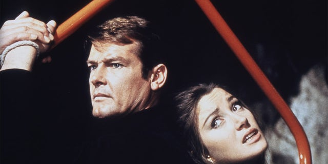 Actor Roger Moore and actress Jane Seymour on the set of 'Live And Let Die.'
