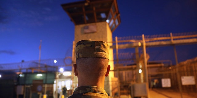 """FILE – GUANTANAMO BAY, CUBA: A U.S. Army soldier stands outside the entrance of the """"Gitmo"""" detention center on October 22, 2016 at the U.S. Naval Station at Guantanamo Bay, Cuba. (Photo by John Moore/Getty Images)"""