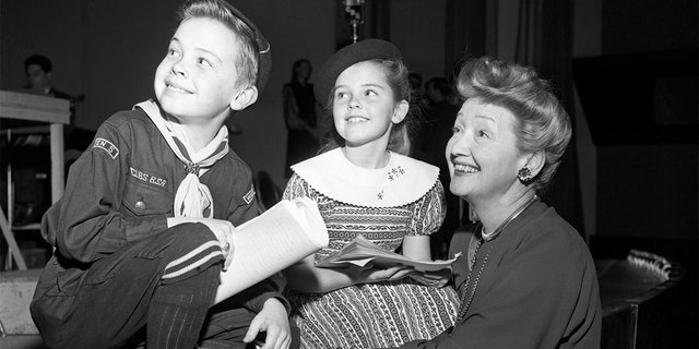 Bobby Driscoll (left) with Hedda Hopper (right) and Luana Patten (center), circa 1947.