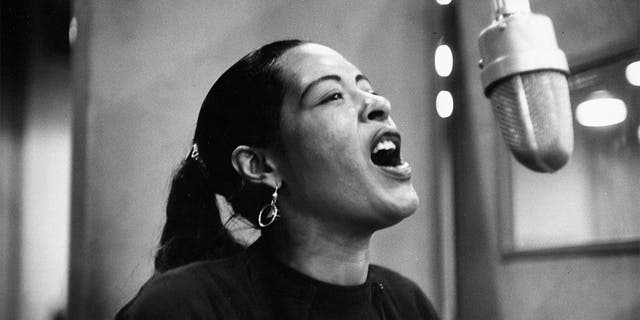 Singer Billie Holiday is pictured here recording her album 'Lady in Satin' at the Columbia Records studio in December 1957. (Photo by Michael Ochs Archives/Getty Images)