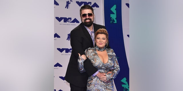 During happier times:? Andrew Glennon, left, and Amber Portwood attend the 2017 MTV Video Music Awards at The Forum on August 27, 2017, in Inglewood, Calif.