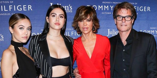 (L-R) Delilah Belle Hamlin, Amelia Gray Hamlin, Lisa Rinna and Harry Hamlin attend the Tommy Hilfiger VIP reception and Julien's Auctions on October 19, 2017 in Los Angeles, California.