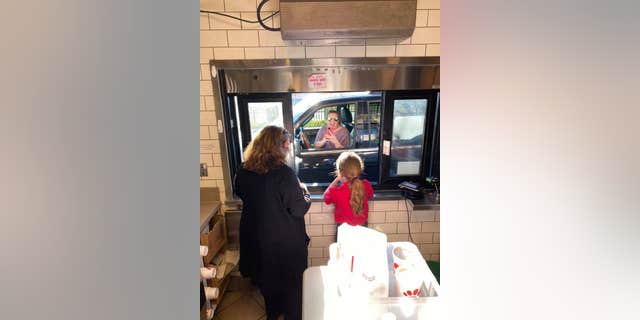 Harper even handed off a milkshake to her mother through the drive-thru.