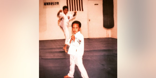 Nicholas Irving poses in martial arts class as child. (Nicholas Irving)