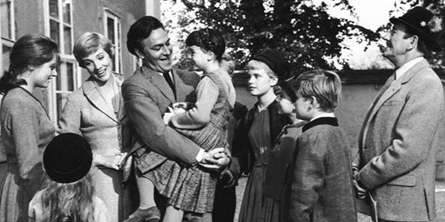 Debbie Turner (being held by Christopher Plummer) starred in 'The Sound of Music' alongside the late actor.