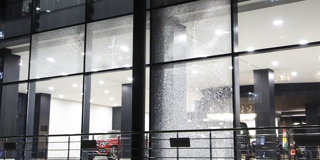 A damage is seen on the windows of an auto showroom at the Gulan Street after two rockets landed inside the Erbil International Airport. (Photo by Yunus Keles/Anadolu Agency via Getty Images)