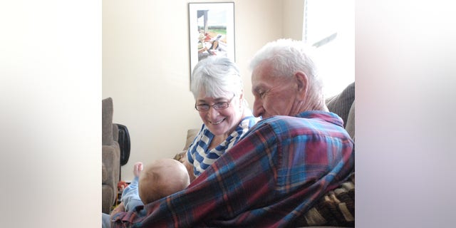 Dee and Mickey Newman and one of their grandsons.