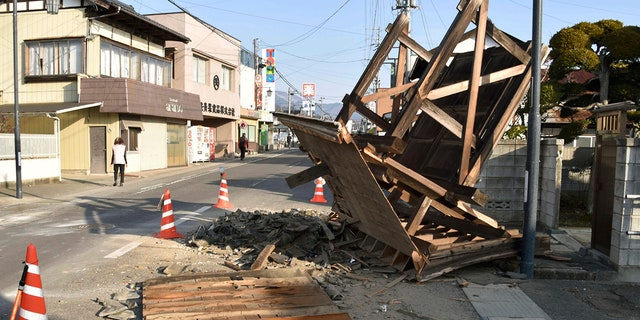This photo shows a damaged entrance of a house in Kori town, north of Fukushima city, northeastern Japan, Sunday, Feb. 14, 2021, following an earthquake Saturday. (Associated Press)