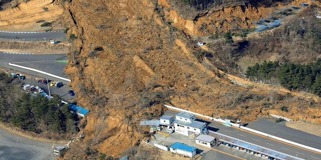 A landslide caused by a strong earthquake covers a circuit course in Nihonmatsu city, Fukushima prefecture, northeastern Japan, Sunday, Feb. 14, 2021. (Associated Press)