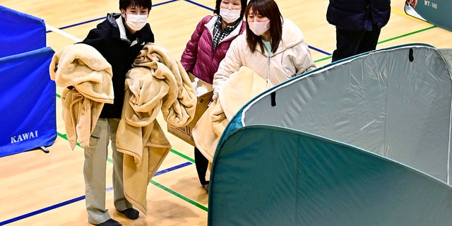 Evacuees shelter at a gym as an earthquake hit the area, in Soma, Fukushima prefecture, northeastern Japan, Sunday, Feb. 14, 2021. (Associated Press)