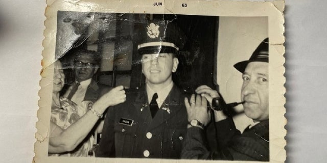 Seymour Kagan's mother and father pin his second liutentant bars on his uniform following his graduation from Rutgers University's ROTC program in 1963. His uncle, in the background, looks on. (Courtesy Seymour Kagan)