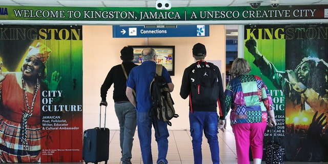 Passengers at Norman Manley International Airport in Jamaica. (Photo by Valery SharifulinTASS via Getty Images)