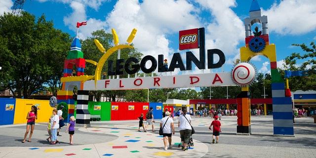 WINTER HAVEN, FL, USA - June 18, 2014: Visitors pass through the entrance to Legoland Florida