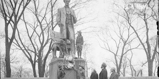 Four Boy Scouts standing at the Lincoln Monument, designed by Augustus Saint Gaudens, in Lincoln Park in Chicago, Ill., in 1929. (Chicago Sun-Times/Chicago Daily News collection/Chicago History Museum/Getty Images)