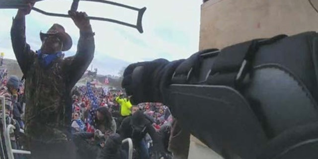 An FBI agent identified Luke Coffee, 41, of Texas as the man in this photo wielding a crutch as a weapon.