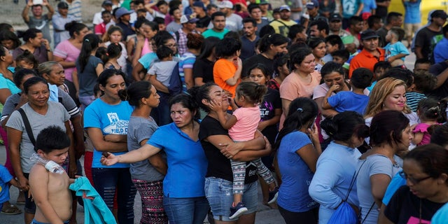 In this August 2019 photo, migrants -- many of whom were returned to Mexico under the Trump administration's
