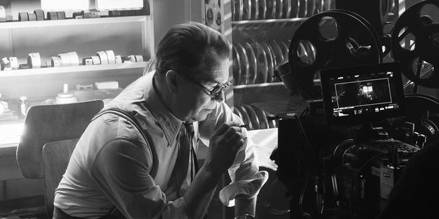 In this image released by Netflix, Gary Oldman portrays Herman Mankiewicz in a scene from 'Mank.'