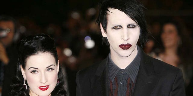 Dita Von Teese (left) has spoken out about the abuse allegations brought against her ex-husband Marilyn Manson (right). She said that she did not experience abuse during their seven-year relationship. (Photo by Richard Lewis/WireImage)