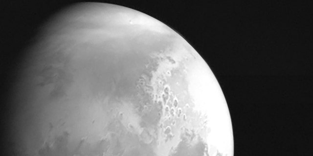 In this undated photo released by the China National Space Administration, a view of the planet Mars is captured by China's Tianwen-1 Mars probe from a distance of 2.2 million kilometers (1.37 million miles). (CNSA/Xinhua via AP)