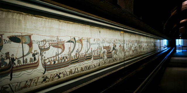 This file photo taken, Sept. 18, 2019 shows a large part of the 11th century Bayeux tapestry chronicling the Norman conquest of England, in Bayeux, Normandy, France. (AP Photo/Kamil Zihnioglu, File)