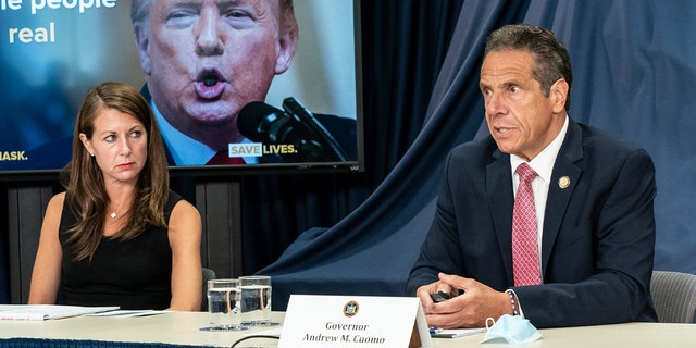 Secretary to the Governor Melissa DeRosa and New York Gov. Andrew Cuomo as he makes an announcement and holds a media briefing at his Third Avenue office in New York City. (Lev Radin/Pacific Press/LightRocket via Getty Images)