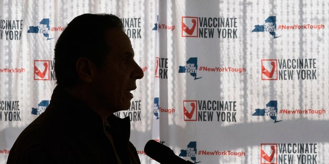 FILE - In this Saturday, Jan. 23, 2021 file photo, Gov. Andrew Cuomo speaks to reporters during a news conference at a COVID-19 pop-up vaccination site in the William Reid Apartments in the Brooklyn borough of New York. More than 9,000 recovering coronavirus patients in New York state were released from hospitals into nursing homes at the height of the pandemic under a controversial order that was scrapped amid criticisms it accelerated outbreaks, according to new records obtained by The Associated Press. (AP Photo/Mary Altaffer, Pool)