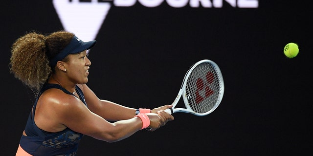 Japan's Naomi Osaka hits a backhand return to United States' Jennifer Brady during the women's singles final at the Australian Open tennis championship in Melbourne, Australia, Saturday, Feb. 20, 2021.(Associated Press)