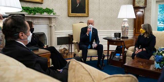 President Joe Biden speaks during a meeting with a bipartisan group of mayors and governors to discuss a coronavirus relief package, in the Oval Office of the White House, Friday, Feb. 12, 2021. (AP Photo/Evan Vucci)