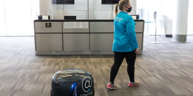 The gita robots use visual sensors to follow an AtYourGate employee through the airport to the person who ordered the food.