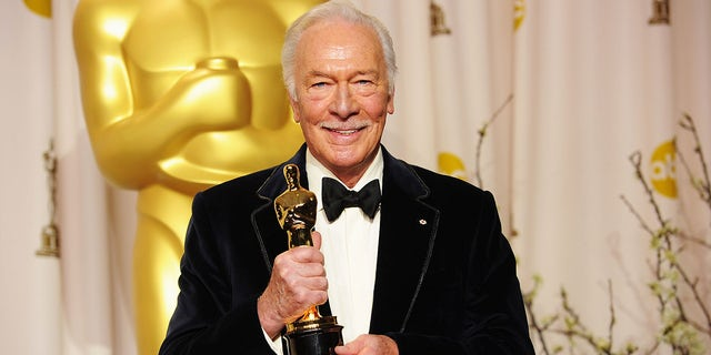 "Christopher Plummer in 2012 poses with his Oscar for Best Supporting Actor Award for his role in ""Beginners."""