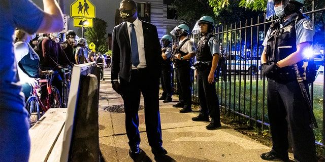 Members of the Chicago Police Department confronted protesters during a march for Breonna Taylor on September 23, 2020 in Chicago, Illinois. (Photo by Natasha Moustache/Getty Images)