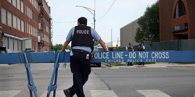 CHICAGO, ILLINOIS - AUGUST 15: Police stand guard as pro and anti-police demonstrators are expected to gather outside of the Homan Square police station on August 15, 2020 in Chicago, Illinois. The demonstration was one of several in the city today, either in support of or in opposition to police. (Photo by Scott Olson/Getty Images)