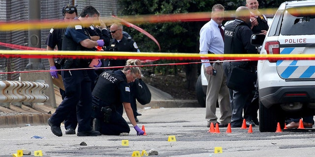 Chicago police officers investigate an officer-involved shooting outside the department's 25th district station on July 30, 2020. According to police, a prisoner was shot and and two officers were wounded. (Antonio Perez/Chicago Tribune/Tribune News Service via Getty Images)