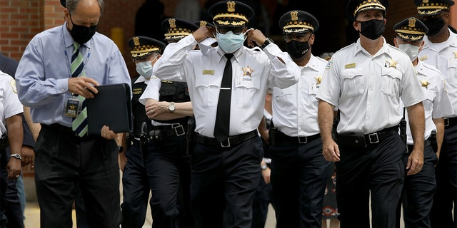 Chicago police Superintendent David Brown, center, walks outside Advocate Illinois Masonic Medical Center to provide information about the police shooting on Thursday, July 30, 2020. (Abel Uribe/Chicago Tribune/Tribune News Service via Getty Images)