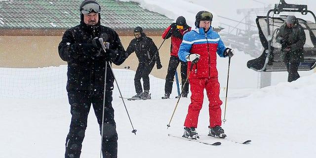 Russian President Vladimir Putin, right, and Belarusian President Alexander Lukashenko arrive at the mountain resort of Krasnaya Polyana near the Black Sea resort of Sochi, Russia, Monday, Feb. 22, 2021. (Alexei Druzhinin, Sputnik, Kremlin Pool Photo via AP)