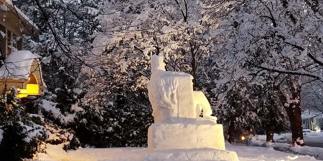 After many hours of carving and shaping, Abe's head and shoulders became clear on Thursday night.
