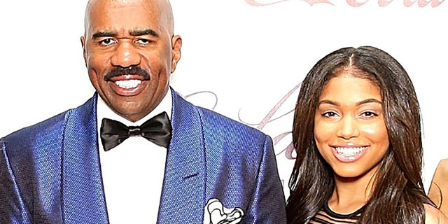 Lori Harvey (right) and her father Steve Harvey (left). (Photo by Neilson Barnard/Getty Images)