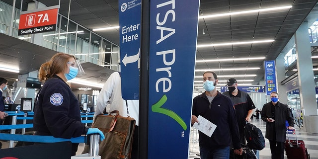 The Transportation Security Administration (TSA) on Friday issued an update to its recent mask mandate for travelers passing through security checkpoints, confirming that violators face fines ranging from $250 up to $1,500 for repeat offenders. (Photo by Scott Olson/Getty Images)