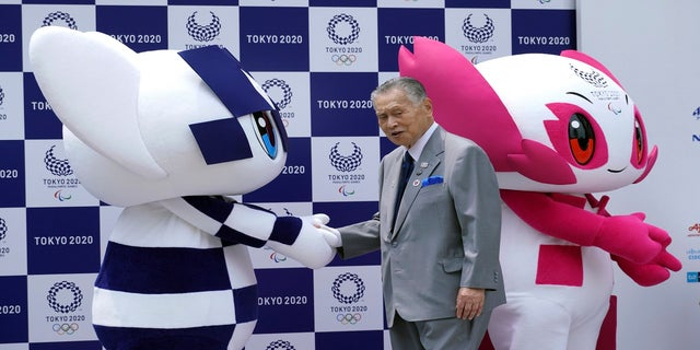 """Tokyo Olympic mascot """"Miraitowa,"""" left, and Paralympic mascot """"Someity,"""" right, and Tokyo Olympic Organizing Committee President Yoshiro Mori on-stage during the mascots' debut event in Tokyo in 2018. (AP)"""