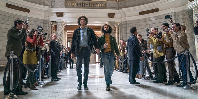 """'This image released by Netflix shows Sacha Baron Cohen, center left, and Jeremy Strong in a scene from """"The Trial of the Chicago 7.'"""